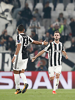 Football Soccer: UEFA Champions League Juventus vs Sporting Clube de Portugal, Allianz Stadium. Turin, Italy, October 18, 2017. <br /> Juventus' Miralem Pjanic (r) celebrates after scoring with his teammates Medhi Benatia (l) during the Uefa Champions League football soccer match between Juventus and Sporting Clube de Portugal at Allianz Stadium in Turin, October 18, 2017.<br /> UPDATE IMAGES PRESS/Isabella Bonotto