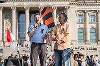 """200 bis 300 Reichsbuerger, Neonazis, Antisemiten und Verschwoerungstheoretiker versammelten sich am 3. Oktober 2014 zu einem """"Sturm auf den Reichstag"""". Die sogenannten Reichsbuerger erkennen die hiesigen Gesetze und Institutionen nicht an. Deutschland sei 1945 nicht befreit sondern besetzt worden und Grenzen des Deutschen Reiches von 1937 wuerden immer noch gelten. Anhaenger dieser Gruppierung fallen immer wieder durch Holocaustleugnung und Volksverhetzung auf.<br /> Zu den Kundgebungsteilnehmern sprach neben bekennenden Rechten auch der deutsche Pop- und Schlagersaenger Xavier Naidoo.<br /> Links im Bild: Der selbsternannte Reichsbuerger Ruediger Hoffmann (alias Ruediger Klasen). Hoffmann war ehem. NPD-Chef in Hagenow und hat wegen einem Brandanschlag auf eine Fluechtlingsunterkunft 3 Jahre in Haft gesessen.<br /> 3.10.2014, Berlin<br /> Copyright: Christian-Ditsch.de<br /> [Inhaltsveraendernde Manipulation des Fotos nur nach ausdruecklicher Genehmigung des Fotografen. Vereinbarungen ueber Abtretung von Persoenlichkeitsrechten/Model Release der abgebildeten Person/Personen liegen nicht vor. NO MODEL RELEASE! Don't publish without copyright Christian-Ditsch.de, Veroeffentlichung nur mit Fotografennennung, sowie gegen Honorar, MwSt. und Beleg. Konto: I N G - D i B a, IBAN DE58500105175400192269, BIC INGDDEFFXXX, Kontakt: post@christian-ditsch.de<br /> Urhebervermerk wird gemaess Paragraph 13 UHG verlangt.]"""