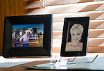 The personal touches on Baffert's desk include a photo of his wife Jill and a photo of Baffert ith his son Bode at Churchill Downs.