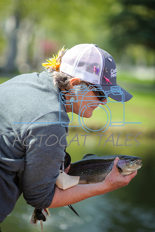 Katie Lambie holds the rainbow trout she caught while participating in the Casting for Recovery fishing clinic at Bently Ranch in Gardnerville, Nev. May 4, 2018.<br /> Photo by Candice Vivien/Nevada Momentum