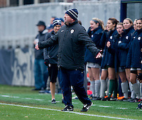 Georgetown head coach Dave Nolan talks to a referee during the first round of the NCAA tournament at Shaw Field in Washington, DC.  Georgetown defeated La Salle, 2-0.