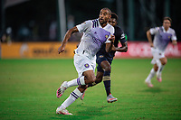 LAKE BUENA VISTA, FL - JULY 20: Tesho Akindele #13 of Orlando City SC looks for the ball during a game between Orlando City SC and Philadelphia Union at Wide World of Sports on July 20, 2020 in Lake Buena Vista, Florida.