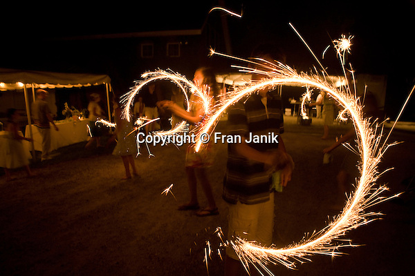 Several children play with sparklers late on a summer evening in southern Vermont.