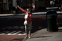 NEW YORK , NY JUNE 16: A woman gestures as she request a taxi the next day as the city mark the end of the COVID-19 restrictions in  New York on June 17 2021. <br /> (Photo by Kena Betancur/VIEWpress)