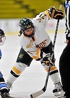 23 November 2011: University of Vermont Catamount forward Amanda Pelkey, a Freshman from Montpelier, VT, takes a face-off against the University of Maine Black Bears at Gutterson Fieldhouse in Burlington, Vermont. The Lady Bears defeated the Lady Cats 5-2 in Hockey East play. Mandatory Credit: Ed Wolfstein Photo