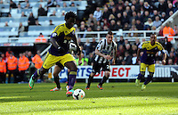 Pictured: Wilfried Bony of Swansea scoring his goal from the penalty spot after Marvin Emnes was brought dowin in the box in stoppage time. Saturday 19 April 2014<br /> Re: Barclay's Premier League, Newcastle United v Swansea City FC at St James Park, Newcastle, UK.