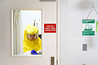 September 22, 2021; Ph.D. student Kathleen Nicholson gets ready to enter the biosafety level 3 facility. (Photo by Matt Cashore/University of Notre Dame)