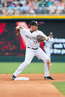 Carlos Sanchez (13) of the Charlotte Knights makes a throw to first base against the Pawtucket Red Sox at BB&T Ballpark on August 10, 2014 in Charlotte, North Carolina.  The Red Sox defeated the Knights  6-4.  (Brian Westerholt/Four Seam Images)