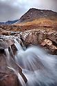 Waterfall on the Allt Coir' a' Mhadaidh river as it cascades down from the Cullin Hills, Glen Brittle, Isle of Skye, Inner Hebrides, Scotland, UK. February.