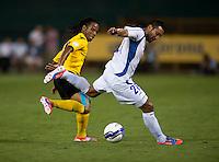 Arturo Alvarez (21) of El Salvador tries to keep the ball away from Andrae Campbell (12) of Jamaica at RFK Stadium in Washington, DC.  Jamaica defeated El Salvador, 2-0.