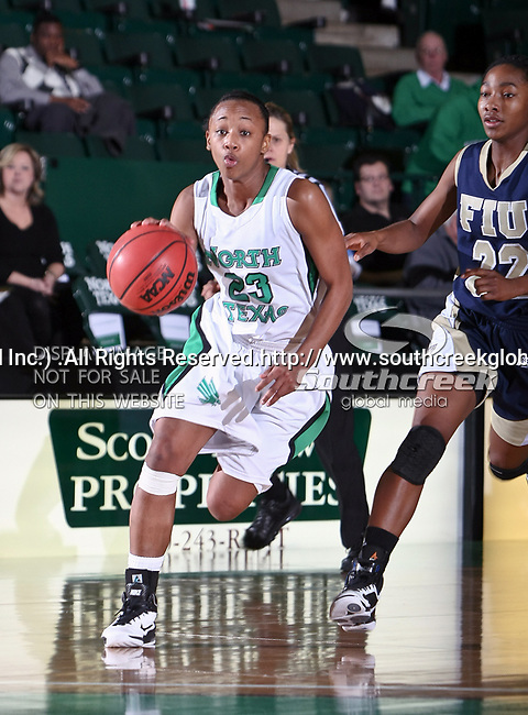 North Texas Mean Green guard Kasondra Foreman (23) drives in towards the basket in the NCAA Womens basketball game between the Florida International University Panthers and the University of North Texas Mean Green at the North Texas Coliseum,the Super Pit, in Denton, Texas. UNT defeated FIU 76 to 69