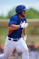 New York Mets left fielder Tim Tebow (15) runs to first base during an Instructional League game against the Miami Marlins on September 29, 2016 at the Port St. Lucie Training Complex in Port St. Lucie, Florida.  (Mike Janes/Four Seam Images)