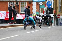 3rd October 2021; London, England: The Virgin Money 2021 London Marathon: Merle Menje of Germany leading a group across the Narrow Street Swing Bridge, Limehouse Basin between mile 14 and 15.