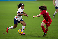 ORLANDO CITY, FL - FEBRUARY 18: Margaret Purce #20 dribbles at Allysha Chapman #2 during a game between Canada and USWNT at Exploria stadium on February 18, 2021 in Orlando City, Florida.