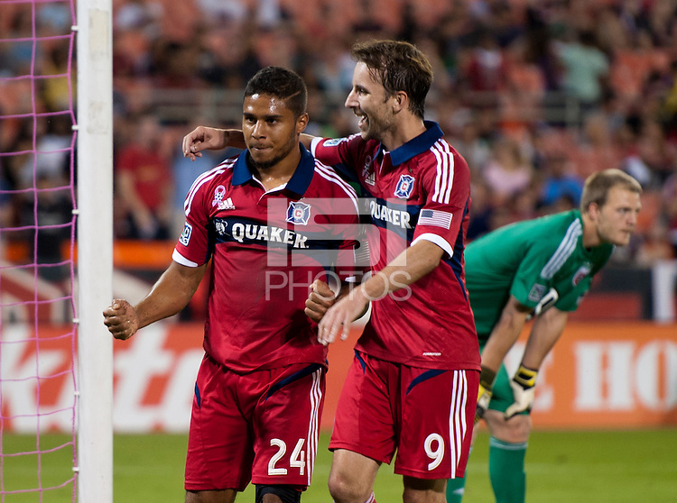 Quincy Amarikwa (24) of the Chicago Fire celebrates his goal with teammate Mike Magee (9) during a Major League Soccer game at RFK Stadium in Washington, DC.  The Chicago Fire defeated D.C. United, 3-0.
