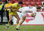 Simon Kennewell of Australia catches the leg of Harry Glover of England during the match Australia vs England, the Bronze Final of Day 2 of the HSBC Singapore Rugby Sevens as part of the World Rugby HSBC World Rugby Sevens Series 2016-17 at the National Stadium on 16 April 2017 in Singapore. Photo by Victor Fraile / Power Sport Images