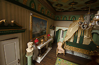 BNPS.co.uk (01202) 558833<br /> Pic: ZacharyCulpin/BNPS<br /> <br /> A model maker who spent 25 years building a stunning miniature Georgian mansion has put it up for sale for £8,750.<br /> <br /> Len Martin spared no expense or time in creating the incredibly ornate model home that includes Swarovski chandeliers, gold furniture and artwork from Egyptian King Farouk's artist.<br /> <br /> The 42ins tall property also boasts a sweeping driveway, 16 statues, 138 balustrades, marble floors, stone cherubs on the ceilings and more tiny oil paintings crafted by real artists.