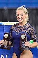 Olympia Samantha Peszek of California with individual all around and individual balance beam NCAA national women's gymnastics championships trophy, Sunday, April 19, 2015 in Fort Worth, Tex.(Mo Khursheed/TFV Media via AP Images)