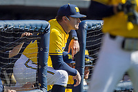 Michigan Wolverines head coach Erik Bakich (23) in the dugout against the Illinois Fighting Illini during the NCAA baseball game on April 8, 2017 at Ray Fisher Stadium in Ann Arbor, Michigan. Michigan defeated Illinois 7-0. (Andrew Woolley/Four Seam Images)