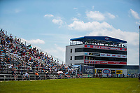 Aug 9, 2020; Clermont, Indiana, USA; NHRA fans sit in the grandstands next to the timing tower and suites during the Indy Nationals at Lucas Oil Raceway. Mandatory Credit: Mark J. Rebilas-USA TODAY Sports