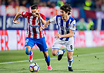 Yannick Ferreira Carrasco (L) of Atletico de Madrid fights for the ball with Esteban Felix Granero Molina (R) of Real Sociedad during their La Liga match between Atletico de Madrid vs Real Sociedad at the Vicente Calderon Stadium on 04 April 2017 in Madrid, Spain. Photo by Diego Gonzalez Souto / Power Sport Images