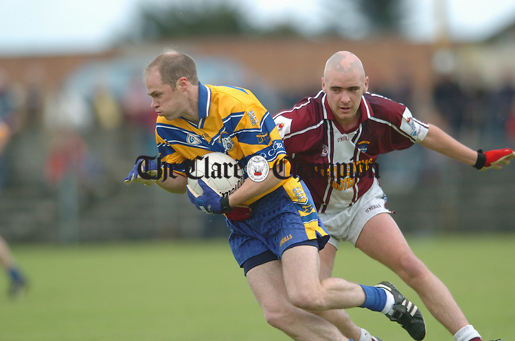 Clare's Michael O Shea is followed by Westmeath's Patrick Mulvihill in Cusack Park. Photograph by John Kelly.