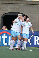 Marian Dalmy (left) and Karen Carney (right) celebrate Ella Masar's first goal in 2-1 Red Stars win.