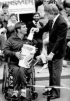 Triumphant moment: A delighted Rick Hansen receives a $1 million cheque from Prime Minister Brian Mulroney yesterday on Parliament Hill. Thousands jammed the hill for the biggest turnout during Hansen's around-the-world Man in Motion wheelchair trek to raise money for spinal cord research.<br /> <br /> Photo : Boris Spremo - Toronto Star archives - AQP