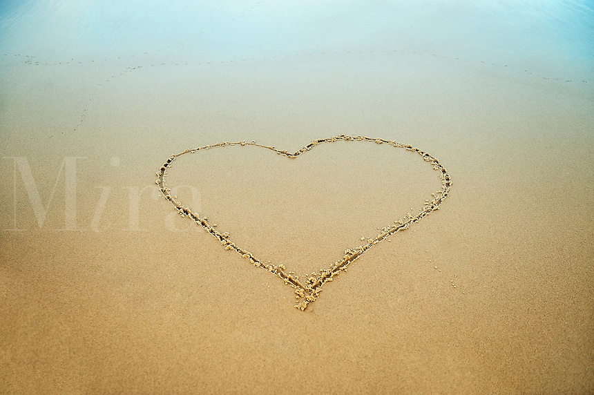 Heart drawn in the beach sand.