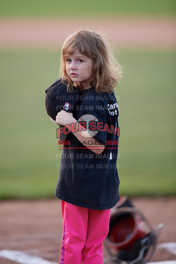A young Batavia Muckdogs fan on the field during the national anthem before a game against the West Virginia Black Bears on June 24, 2017 at Dwyer Stadium in Batavia, New York.  The game was suspended in the bottom of the third inning and completed on June 25th with West Virginia defeating Batavia 6-4.  (Mike Janes/Four Seam Images)