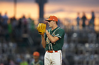 Greensboro Grasshoppers starting pitcher Trevor Rogers (26) looks to his catcher for the sign against the West Virginia Power at First National Bank Field on June 1, 2018 in Greensboro, North Carolina. The Grasshoppers defeated the Power 10-3. (Brian Westerholt/Four Seam Images)