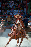 A Mexican cowboy (goucho) on horseback at the Charros Rodeo Fiesta Event. San Antonio, Texas.