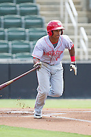 Wilmer Difo (6) of the Hagerstown Suns hustles down the first base line against the Kannapolis Intimidators at CMC-Northeast Stadium on June 1, 2014 in Kannapolis, North Carolina.  The Intimidators defeated the Suns 5-1 in game one of a double-header.  (Brian Westerholt/Four Seam Images)