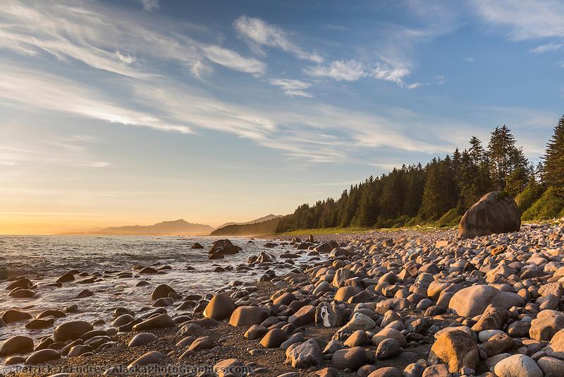 Sunset and rocky beach along the Gulf of Alaska, Mt. Fairweather, Pacific Ocean coast, Glacier Bay National Park, Southeast, Alaska