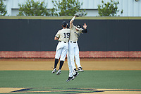Christian Long (19), Michael Ludowig (22), and D.J. Poteet (4) of the Wake Forest Demon Deacons celebrate following their win over the Virginia Cavaliers at David F. Couch Ballpark on May 19, 2018 in  Winston-Salem, North Carolina. The Demon Deacons defeated the Cavaliers 18-12. (Brian Westerholt/Four Seam Images)