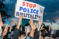 """Thousands gathered outside the Massachusetts State House in Boston, Massachusetts, on Sun., May 31, 2020, to demonstrate against police brutality after the killing by police of George Floyd in Minneapolis, Minnesota, the previous week. Protests, sometimes violent, have erupted around the United States. This protest was organized by an organization called Black Boston. Protesters often chanted """"Black Lives Matter"""" and """"Fuck the police."""" The protest began at 6:30pm in various parts of the city, and around 9pm, after most protesters had left, there began to be clashes between people and police, especially in the Downtown Crossing area of Boston and around Boston Common.  The protest sign here reads """"Stop police brutality / I can't breathe."""""""