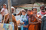 12 March 2013, Kanpur, Uttar Pradesh India: A local family outside their small home during the visit of the President of the World Bank, Mr Jim Yong Kim  to the low income suburb of Gwaltoli during his tour of Kanpur in Uttar Pradesh state, India. Mr.Kim is visiting India  for meetings with local staff, Indian Government Ministers and to inspect projects sponsored by World Bank in regional areas. Picture by Graham Crouch/World Bank