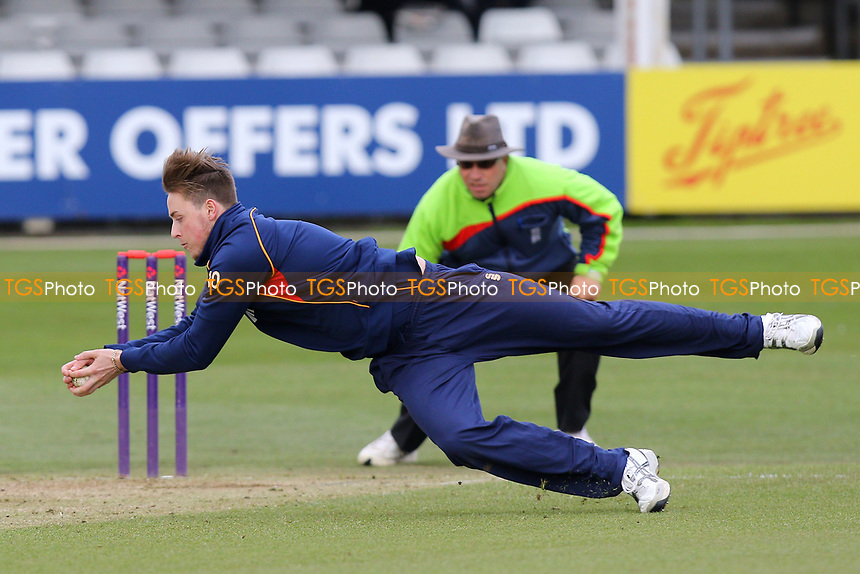 Ollie Robinson of Essex takes a catch off his own bowling to dismiss Stevie Eskinazi during Essex CCC vs Middlesex CCC, T20 Pre-Season Friendly Cricket at the Essex County Ground on 26th March 2015