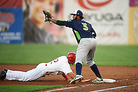 Vermont Lake Monsters first baseman Miguel Guzman (3) stretches for a throw  as Jake Noll (12) dives back to the bag during a game against the Auburn Doubledays on July 12, 2016 at Falcon Park in Auburn, New York.  Auburn defeated Vermont 3-1.  (Mike Janes/Four Seam Images)