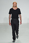 Model walks runway in a navy pocket tee and single pleat shark trouser from the Palmiers du Mal Spring Summer 2017 collection by Brandon Capps and Shane Fonner, at Skylight Clarkson Square on July 14 2016, during New York Fashion Week Men's Spring Summer 2017.