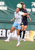 Sonia Bompastor #8 of Washington Freedom goes for a header with Carli Lloyd #10 of Chicago Red Stars during a WPS match at RFK Stadium on June 13 2009, in Washington D.C.