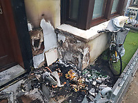 """Pictured: The damage caused outside the house.<br />Re: A terrified family was left trapped inside their smoke-filled home when a Cardigan man started a fire outside the wrong house.<br />Nathan Lee Jones, of Golwg y Castell, set bin bags on fire outside a house in Castle Street in an act of arson earlier this year.<br />However the 42-year-old had targeted the wrong house, leaving a young family of four fearing for their lives as their only exit caught ablaze.<br />Jones was identified and arrested following a rigorous investigation by Dyfed-Powys Police detectives, with support from teams across Ceredigion.<br />He has now been jailed for four years for arson with intent to endanger life.<br />Officer in case Detective Constable Damon Watmough said: """"This was a very serious and traumatic incident, which could have had devastating consequences for the victims.<br />""""The defendant was determined to cause fear or harm by starting the fire, and put the lives of a family with two young children at risk.<br />""""We hope this sentence will provide reassurance to the community and victims following this distressing incident.""""<br />Police were made aware of the fire at around 3am on June 16, 2020, and an investigation was immediately launched.<br />Despite initial suggestions that it was accidentally caused by a lit cigarette, detectives were able to prove the blaze had been started deliberately.<br />Enquiries carried out into conversations on social media identified the defendant as being involved in the incident, and he was swiftly arrested.<br />DC Watmough said: """"As the investigation progressed, we discovered the fire was started intentionally, but not at the home Jones intended to target.<br />""""He actually went back to try and put the fire out, however it appears a black bag was still smouldering, and spread to the other refuse outside the house.<br />""""By the time the occupants were aware, they had no means of escape, and a gas pipe had been damaged and was leaking int"""