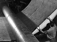 Steel under giant rolls being shaped for submarine construction at Electric Boat Co.l, Groton, Conn. August 1943.  Lt. Comdr. Charles Fenno Jacobs.  (Navy)<br /> Exact Date Shot Unknown<br /> NARA FILE #:  080-G-468488<br /> WAR & CONFLICT BOOK #:  816