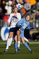North Carolina Tar Heels forward Courtney Jones (84) challenges Notre Dame Fighting Irish defender Carrie Dew (19) for the ball. The North Carolina Tar Heels defeated the Notre Dame Fighting Irish 2-1 during the finals of the NCAA Women's College Cup at Wakemed Soccer Park in Cary, NC, on December 7, 2008. Photo by Howard C. Smith/isiphotos.com