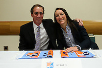 INDIANAPOLIS, IN - January 18, 2013: Sky Blue FC coach Jim Gabarra (left) and player Jillian Loyden (left). The National Women's Soccer League held its college draft at the Indiana Convention Center in Indianapolis, Indiana during the NSCAA Annual Convention.