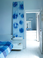 This tranquil blue and white bedroom is situated in the old part of the house which was once a worker's cottage