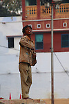 Indian children love flying kites, often from rooftops. The lines are coated with ground glass, with the aim of cutting another kite line and capturing it