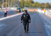 Oct 4, 2020; Madison, Illinois, USA; Crew member for NHRA top fuel driver Leah Pruett during the Midwest Nationals at World Wide Technology Raceway. Mandatory Credit: Mark J. Rebilas-USA TODAY Sports