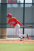 Philadelphia Phillies Christian Valerio (13) follows through on a swing a Florida Instructional League game against the Atlanta Braves on October 5, 2018 at the Carpenter Complex in Clearwater, Florida.  (Mike Janes/Four Seam Images)
