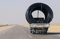 EGYPT, road Cairo to Baharia, desert farming, transport of pipes for desert farming projects/ AEGYPTEN,  Landwirtschaft in der Wueste, Transport von Rohren zur Bewaesserung fuer Landwirtschaft in der Wueste